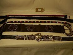 A collection of 5 belts some vintage - to include a Jewelled and beaded belt.