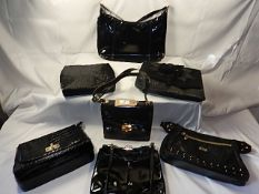 A collection of 7 Black bags to include - Next and Vintage St Michael (some leather)