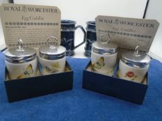 2 x RNLI mugs made by Holkham pottery and 2 boxed sets of Royal Worcester egg coddlers, all in