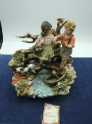 Capodimonte Boy and Girl Figurine
