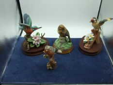 4 Bird Figurines tallest 8 inches
