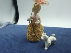 Vintage Ceramic Lady walking her dog 5 1/2 inches tall including parasol