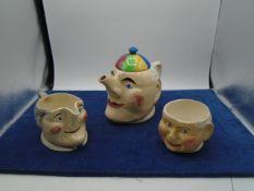 -------rythm tea pot, sugar bowl, milk jug. Teapot lid has been repaired