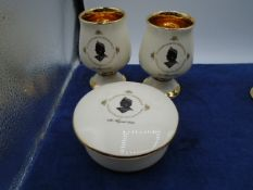 Prink Nash pottery, pair of guilded goblets and dish commemorating queen mothers 80th birthday, in