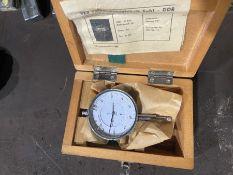 dial gauge in wooden box