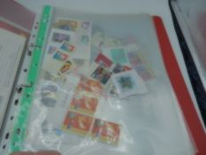 folder and booklet of stamps