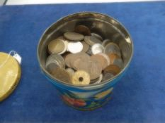 Tin of mixed foreign coins