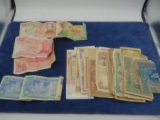 Paper money Singapore x2 (blue) plus 5 Argentina, 100 pesos x2 (red) Uruguay, 5000 pesos (brown)