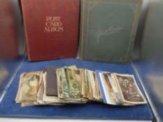 2 albums of post cards, newspaper clippings photos etc