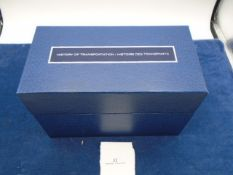 A boxed set of uncirculated stamps on cards 'History of Transportation' about 100 cards/stamps
