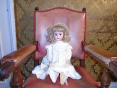 A vintage composite bisque faced doll marked '11' fully articulated with brown sleepy eyes. Possibly