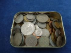 Tobacco tin of mixed foreign coinage (mostly modern)