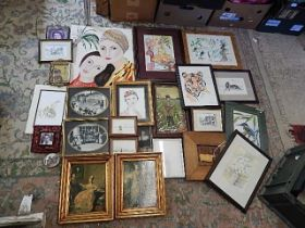 collection of framed pictures