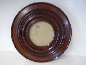 printed portrait of a lady in round mahogany frame25cm