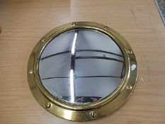 "Brass porthole mirror 15"" across"