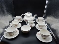 Royal Doulton 'tumbling leaves' part tea service comprising of teapot, 6 cups and saucers, milk