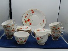 Colclough part tea set decorated with poppies, comprising of 6 cups and saucers, 6 cake plates and