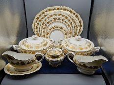 Hammersly part dinner service, cream with gilt flower garland design comprising of 2 lidded