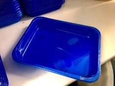 Approximately 230 small blue product trays