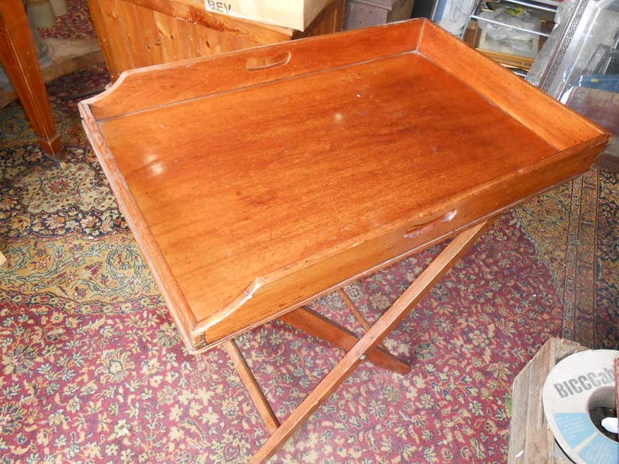 Mahogany Butlers Tray with folding mahogany stand . Tray is 29 x 19 inches stand is 30 inches tall
