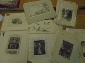 A red folder with about 80-100 various prints