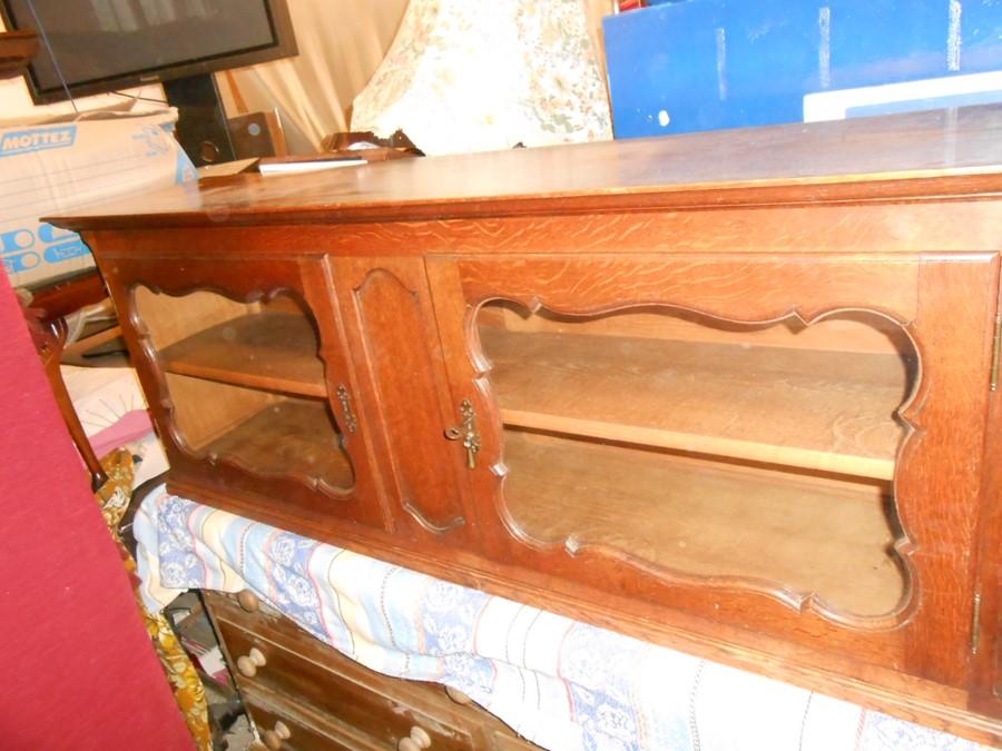 Oak 2 Door Cabinet with glazed doors and one key 146 cm wide 34 deep 55 cm tall