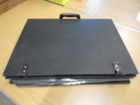 A black carry case with some 25 'pages' of prints- various about 150 in total
