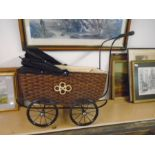 Antique style wicker dolls pram (German) NOT safe for children's use, has been used to display