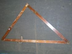 A military mahogany artillery folding square with spirit level and plumb bob