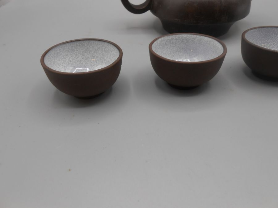 Japanese Ceramic Teapot 3 inches tall and 4 Saki cups - Image 2 of 7