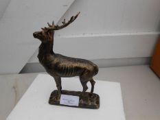 Cast deer on base figure