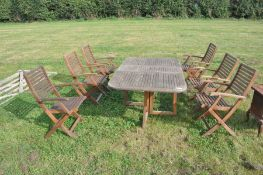 solid Teak garden table with 8 teak folding chairs