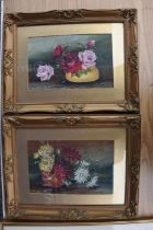 A pair of oil on board still life pictures of flowers in gilt frames 47 x 37 cm