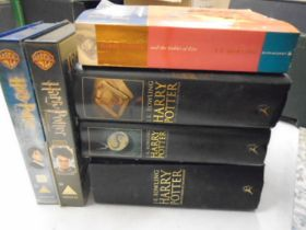 Harry Potter 'first edition' books and some other books plus Harry Potter DVDs