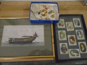 Silk picture of a chinese boat with framed cigarette silks and some loose cigarette silks