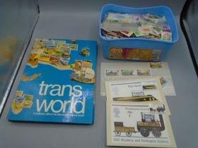 Tub of stamps and an empty stamp collecting album