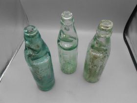 2 Alma Woods Walpole and Wisbech Codd bottles ( one chipped at neck ) and Chas Oldham Wisbech Codd