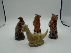 2 Beswick Beneagles scotch whiskey decanters of the Loch Ness Monster and an eagle plus 2 Wade