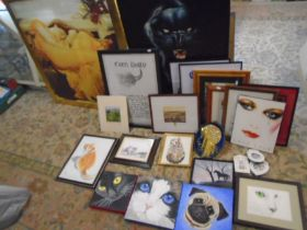 A large collection of framed pictures