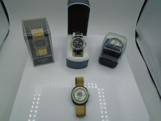 A boxed Blue Harbour watch, a boxed Casio Quartz watch, a boxed Lorus sports watch and a vintage