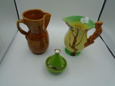 A Burleigh ware Squirrel handled jug 20cm tall, a brown glazed stone ware jug 20cm and a Moroccan