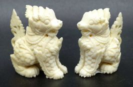 Two Oriental carved Temple Dogs