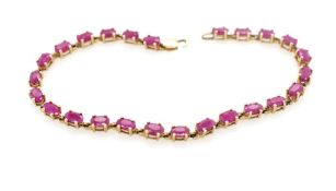 Ruby and yellow gold line bracelet