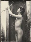 Gloeden, Wilhelm von: Young male nude in doorway with blossom branch