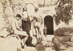Gloeden, Wilhelm von: Three male nudes and boy on terrace