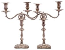 A pair of George V silver twin-branch candelabra, maker Joseph Rodgers & Sons, Sheffield,
