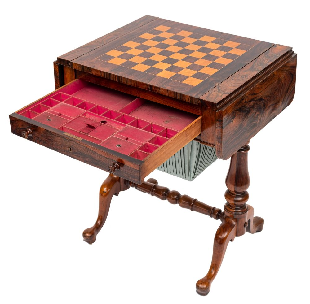 A Victorian rosewood games and work table:, the hinged top with rounded corners,