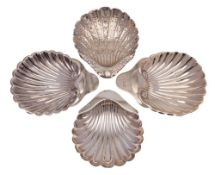 Four assorted silver butter dishes, various makers and dates: of shell-shaped outline,