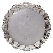 A pair of George II silver waiters, maker William Peaston, London, 1751: crested and initialled,