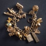 A 9ct gold curb-link bracelet with twenty one various attached hallmarked and stamped charms: to